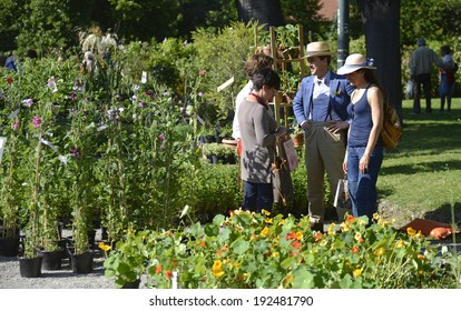 MILAN, ITALY-MAY 09, 2014: visitors watching and buying plants during the floral market exhibition Orticola, in Milan.