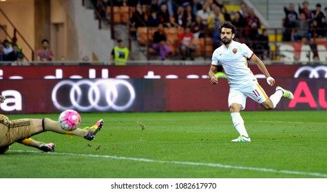 MILAN, ITALY-MAY 14, 2016: AS Roma's egyptian soccer player Mohamed Salah, scores a goal during the italian league's match AC Milan vs AS Roma, at the san siro stadium, in Milan.