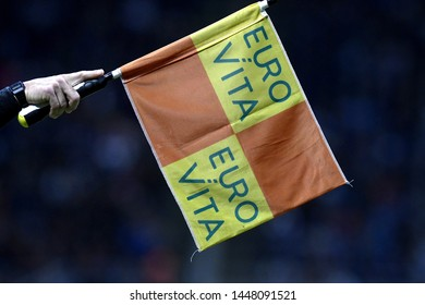 MILAN, ITALY-MAY 26, 2019:  soccer's  linesman holding flag to point a soccer offside, in Milan.