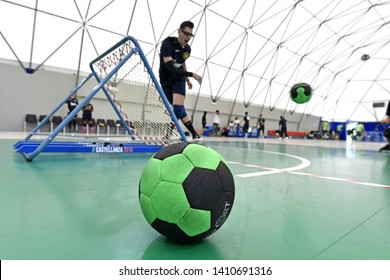 MILAN, ITALY-MAY 26, 2019: tchoukball players action seen behind a tchoukball goal net, during a tchouklball match, in Milan.