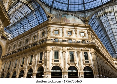 MILAN, ITALY-MAY 9, 2020: Prada store sign, Gallery of Vittorio Emanuele,  glass arcades intersecting in the central octagon, closed shop during coronavirus epidemic period. Second phase of quarantine