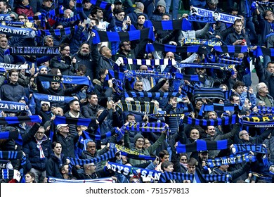 MILAN, ITALY-NOVEMBER 05, 2017: FC Internazionale soccer fans cheering waving their scarfs at the san siro soccer stadium, in Milan.