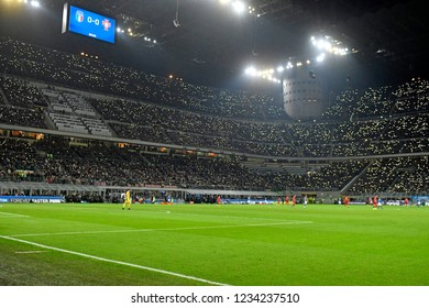 MILAN, ITALY-NOVEMBER 17, 2018: stadium football fans cheer on and light phone lights, at the san siro soccer stadium, during the match Italy vs Portugal, in Milan.