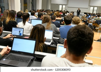 MILAN, ITALY-OCTOBER 01, 2018: students attend a University lecture on a conference room, in Milan.