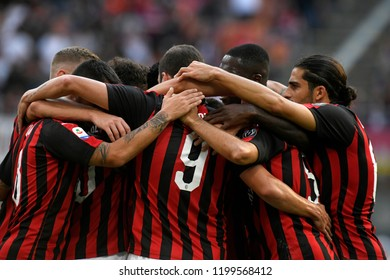 MILAN, ITALY-OCTOBER 07, 2018:  AC Milan soccer players embrace to celebrate the win during the italian league, in Milan.