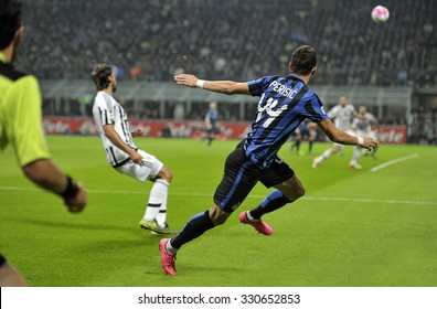 MILAN, ITALY-OCTOBER 18, 2015: soccer players in action during the italian professional soccer match FC Internazionale vs FC Juventus, at San Siro stadium, in Milan.