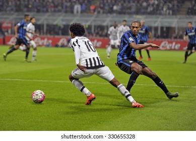 MILAN, ITALY-OCTOBER 18, 2015: soccer players juan cuadrado and juan jesusin action during the italian professional soccer match FC Internazionale vs FC Juventus, at San Siro stadium, in Milan.