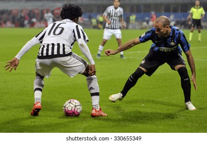 MILAN, ITALY-OCTOBER 18, 2015: soccer players juan cuadrado and rodrigo palacio in action during the italian professional soccer match FC Internazionale vs FC Juventus, at San Siro stadium, in Milan.