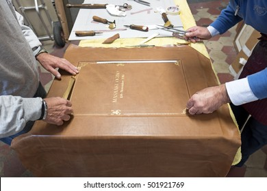 MILAN, ITALY-OCTOBER 19, 2016: artisan hands working on a bindery workshop, in Milan.
