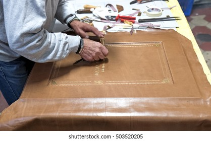 MILAN, ITALY-OCTOBER 19, 2016: handcraft worker on a vintage bindery workshop, in milan.