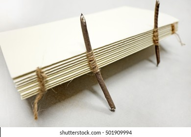 MILAN, ITALY-OCTOBER 19, 2016: handmade paper book on bindery table work, in Milan.