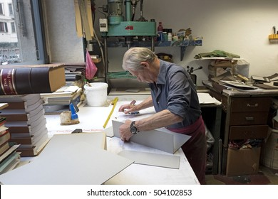 MILAN, ITALY-OCTOBER 19, 2016: handyman worker on a vintage bindery workshop, in Milan.