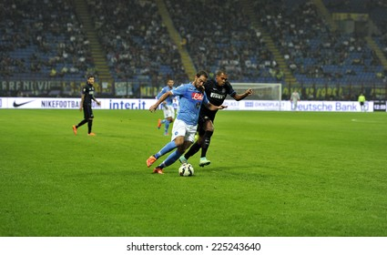 MILAN, ITALY-OCTOBER 19,2014: players Juan Jesus and Gonzalo Higuain in action during the Italian serie A night soccer match FC Internazionale vs  Napoli at the san siro stadium, in Milan.