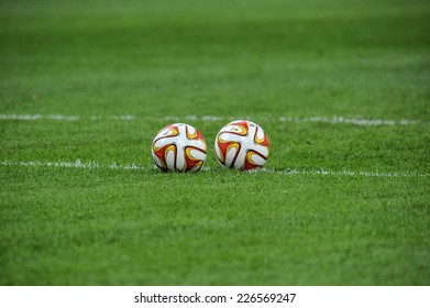 MILAN, ITALY-OCTOBER 23, 2014: soccer ball on the grass of the san siro stadium before the professional UEFA Europa league match FC Internazionale vs St Etienne, in Milan.