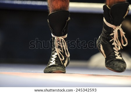 MILAN, ITALY-SEPTEMBER 03, 2009:  amateur boxers close up legs on the ring during the amateur world boxing championship, in Milan.