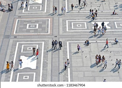 MILAN, ITALY-SEPTEMBER 06, 2018: top view of people walking on Duomo square, in Milan.