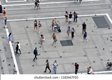 MILAN, ITALY-SEPTEMBER 06, 2018: top view of people walking on Duomo square, in Milan.