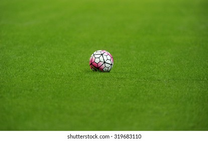 MILAN, ITALY-SEPTEMBER 13, 2015: soccer ball on grass during the milanese derby FC Internazionale vs AC Milan at the San Siro stadium, in Milan.