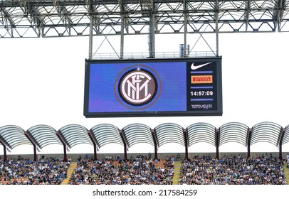 MILAN, ITALY-SEPTEMBER 14, 2014: electronic score board with soccer fans at San Siro stadium watching the Serie A professional soccer match Inter vs Sassuolo, in Milan.