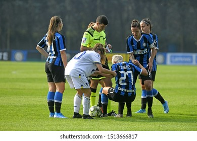 MILAN, ITALY-SEPTEMBER 14, 2019: female soccer players fair play during the italian female professional soccer league match Inter Milan vs Hellas Verona, in Milan.