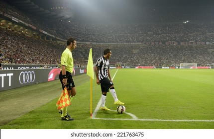 MILAN, ITALY-SEPTEMBER 20, 2014: FC Juventus player Carlos Tevez ready to kick a corner, during the italian serie A soccer match AC Milan vs FC Juventus, at the san siro stadium, in Milan.