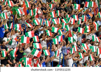 MILAN, ITALY-SEPTEMBER 21, 2018: italian fans cheering and waving italian flags at the indoor Forum arena, during the Volleyball Men's World Championship, in Milan.