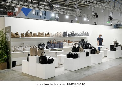 MILAN, ITALY-SEPTEMBER 21, 2020: because of the pandemic crisis a very few visitors are seen inside the international fair of shoes and leather goods, Micam and Mipel, in Milan.