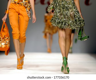 MILAN, ITALY-SEPTEMBER 24, 2009: Models catwalk runway during the Blugirl fashion show of the spring-summer collection.