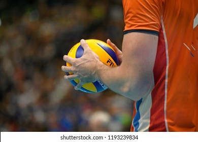 MILAN, ITALY-SEPTEMBER 24, 2018: close up Volleyball player hands holding the ball, during the Volleyball Men's World Championship Italy and Bulgaria 2018, Italy vs Netherlands, in Milan.