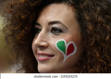 MILAN, ITALY-SEPTEMBER 24, 2018: italian girl with Italy's heart colors, painted on her face, during the Volleyball Men's World Championship Italy and Bulgaria 2018, in Milan.