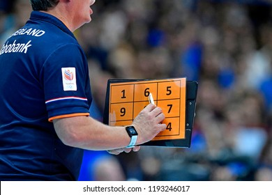 MILAN, ITALY-SEPTEMBER 24, 2018: Volleyball's coach holding numerical folder during the Volleyball Men's World Championship Italy and Bulgaria 2018, Italy vs Netherlands, in Milan.