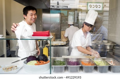 MILAN, ITALY-SEPTEMBER 29, 2016: cooks working on a Chinese street food shop at Chinatown, in Milan.