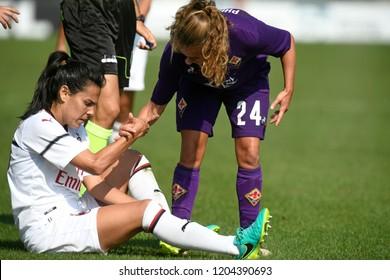 MILAN, ITALY-SEPTEMBER 30, 2018: female soccer players fair play during the italian match AC Milan vs Fiorentina, in Milan.