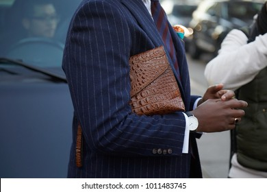 f5ec01ab4c6 MILAN - JANUARY 13  Man with brown crocodile leather bag and blue pinstripe jacket  before