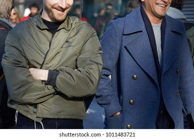 c43a826f38c MILAN - JANUARY 13  Men with green jacket and blue coat before Emporio  Armani fashion