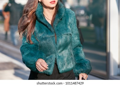 b14d1630bb9 MILAN - JANUARY 13  Woman with green blue fur coat before Emporio Armani  fashion show