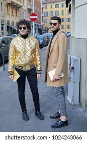 MILAN - JANUARY 14: Men with golden bomber jacket and beige coat before Daks fashion show, Milan Fashion Week street style on January 14, 2018 in Milan.