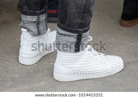 4a253612ee1494 MILAN - JANUARY 15  Man with Louboutin white sneakers shoes with studs  before Fendi fashion