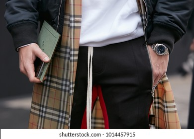 MILAN - JANUARY 15: Man with Rolex Datejust with blue dial and brown raincoat before Pal Zileri fashion show, Milan Fashion Week street style on January 15, 2018 in Milan.