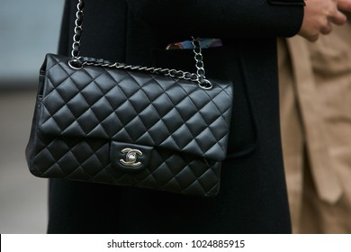 8ad8d90ee5 MILAN - JANUARY 15  Woman with black Chanel leather bag with silver chain  before Giorgio
