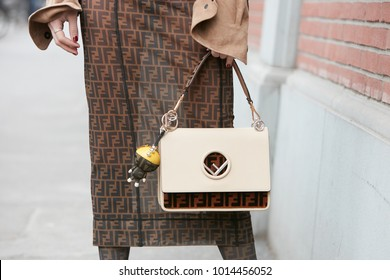 MILAN - JANUARY 15: Woman with Fendi bag and skirt before Fendi fashion show, Milan Fashion Week street style on January 15, 2018 in Milan.