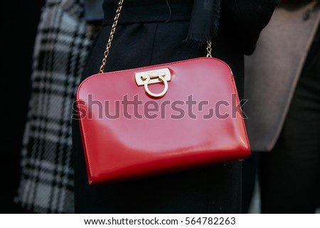0cac7a898f1a MILAN - JANUARY 15  Woman with Ferragamo red leather bag before Salvatore Ferragamo  fashion show