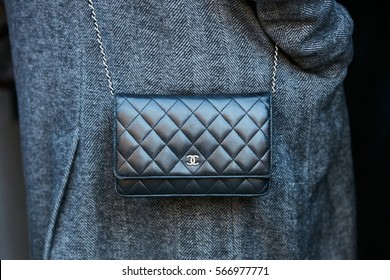 MILAN - JANUARY 16: Woman with small black Chanel leather bag before N 21 fashion show, Milan Fashion Week street style on January 16, 2017 in Milan.