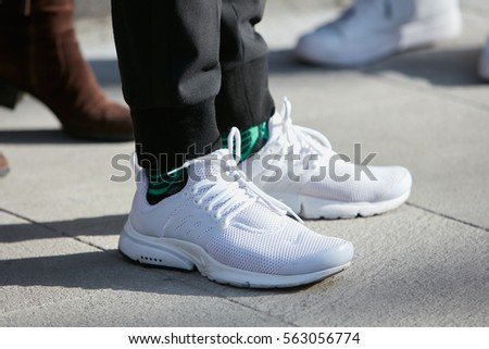 super popular 8d3ad 3b912 MILAN - JANUARY 17  Man with white Nike shoes before Giorgio Armani fashion  show,