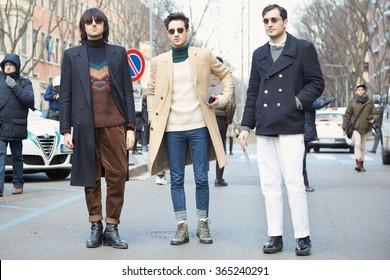 MILAN - JANUARY 19: Three stylish men poses for photographers before Giorgio Armani fashion show on January 19, 2015 in Milan, Italy. Man fashion fall winter 2016 / 2017