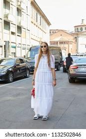 MILAN - JUNE 16: Carlotta Oddi with white dress before Marni fashion show, Milan Fashion Week street style on June 16, 2018 in Milan.