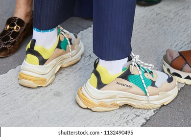 MILAN - JUNE 16: Man with Balenciaga shoes in beige, yellow and green colors before Marni fashion show, Milan Fashion Week street style on June 16, 2018 in Milan.