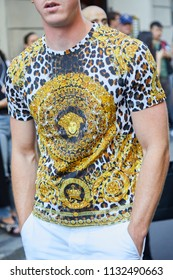 MILAN - JUNE 16: Man with Versace leopard dappled t-shirt with golden decorations before Versace fashion show, Milan Fashion Week street style on June 16, 2018 in Milan.