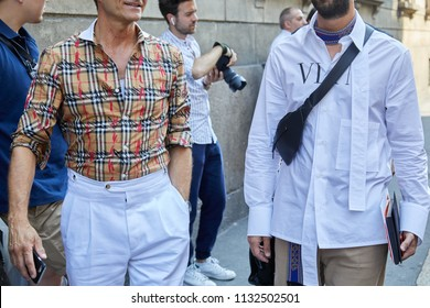 MILAN - JUNE 16: Men with Burberry shirt and Valentino white shirt walking before Les Hommes fashion show, Milan Fashion Week street style on June 16, 2018 in Milan.