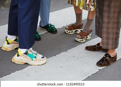 MILAN - JUNE 16: People with Balenciaga, Gucci and fashion shoes before Marni fashion show, Milan Fashion Week street style on June 16, 2018 in Milan.